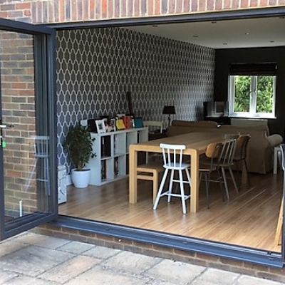 Image: 2017-07/anthracite-grey-3-pane-bifolding-door-fully-open.jpg
