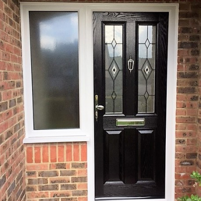 Image: 2017-09/essex-door-in-black-with-black-fusion-style-1-glazing-and-adjacent-window-in-stippolyte.jpg