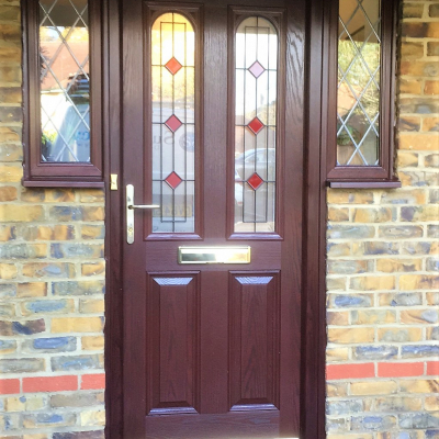 Image: 2017-10/surrey-door-in-dark-wood-with-rosewood-frame-and-resin-lead-red-glazing.jpg