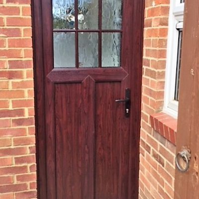 Image: 2017-12/emplas-back-door-in-rosewood-with-sculptured-bead-and-flemish-glazing.jpg
