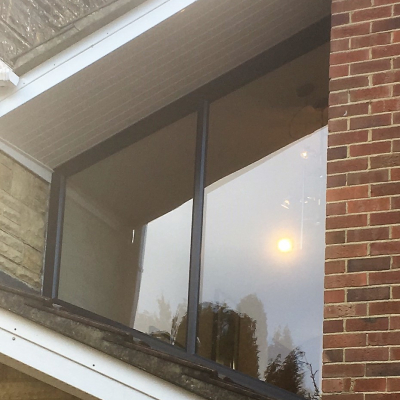 Image: 2018-01/1517223985_emplas-profile-22-optima-chamfered-casement-window-in-anthracite-grey-on-white-pvcu-external.jpg