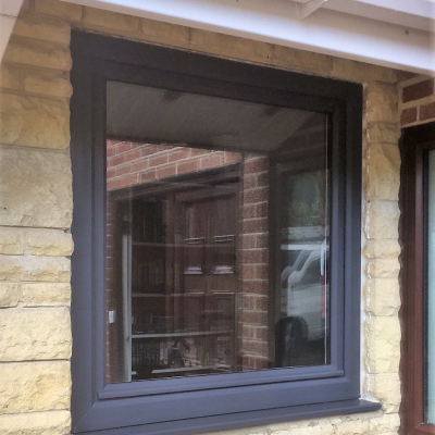 Image: 2018-01/emplas-profile-22-optima-tilt-and-turn-window-with-chamfered-bead-in-anthracite-grey-on-white-pvcu.jpg