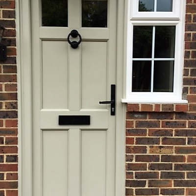 Image: 2018-07/maple-front-door-in-olive-grey-with-wrought-iron-hardware.jpg