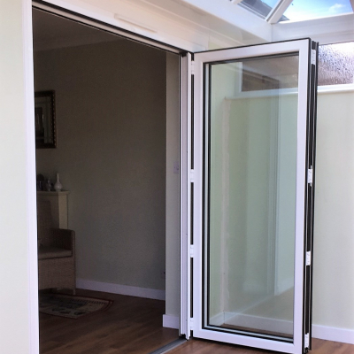 Image: 2018-08/white-powder-coated-aluminium-2-pane-bifolding-door-in-open-position.jpg