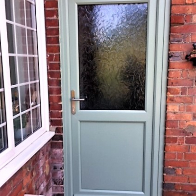 Image: 2018-09/emplas-chartwell-green-entrance-door-with-solid-lower-panel-and-autumn-obscure-glazing.jpg