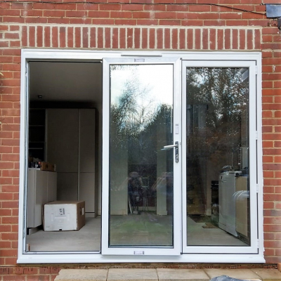 Image: 2018-11/3-pane-triple-glazed-bifolding-door-with-traffic-door-open.jpg