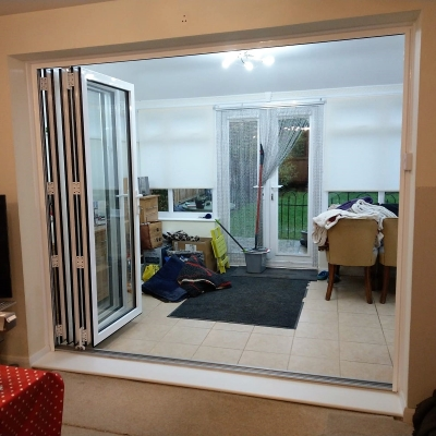 Image: 2018-12/1544179960_white-powder-coated-aluminium-3-pane-bifolding-door-internal-view-fully-open2.jpg
