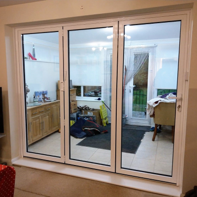 Image: 2018-12/white-powder-coated-aluminium-3-pane-bifolding-door-internal-view.jpg