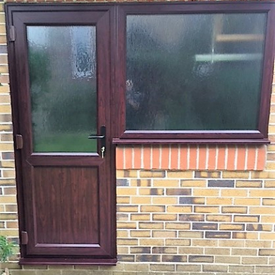 Image: 2019-01/emplas-chamfered-garage-door-and-window-in-rosewood-with-charcoal-sticks-obscured-glass-and-black-handle.jpg