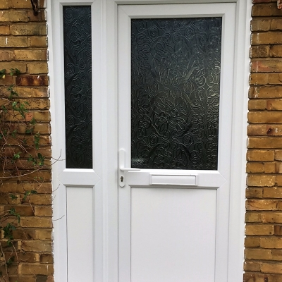 Image: 2019-01/emplas-white-upvc-front-door-and-side-panel-with-everglade-obscured-glazing.jpg