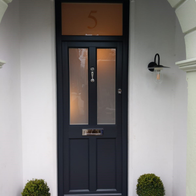 Image: 2019-03/ashwell-front-door-in-anthracite-grey-externally-and-white-woodgrain-internally.-sandblast-glazing-to-door-and-top-light..jpg