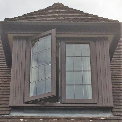 Image: 2019-07/storm-2-casement-window-in-natural-wood-externally-and-white-woodgrain-internally-with-6mm-antique-square-leads.jpg