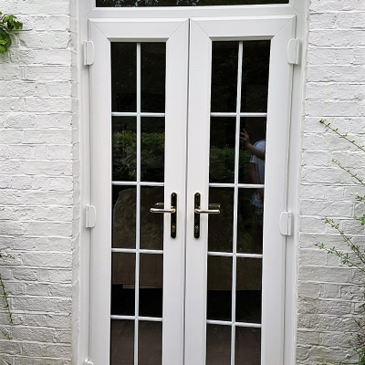 Image: 2019-08/external-view-of-white-upvc-french-door-and-top-light-with-georgian-bar-detail-to-doors.jpg