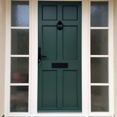 Image: 2019-08/maple-front-door-with-timber-look-joints-in-ral-colour-6028-with-wrought-iron-hardware-and-two-side-panels-in-white-with-cotswold-obscure-glazing-and-horizontal-bars.jpg