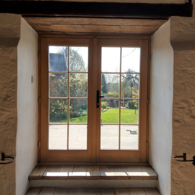Image: 2019-11/redwood-timber-traditional-flush-french-doors-in-traffic-white-with-georgian-astragal-bar-and-cairngorm-antique-black-handles-internal-view.jpg