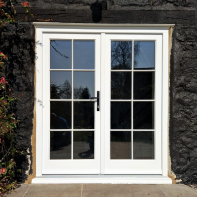 Image: 2019-11/redwood-timber-traditional-flush-french-doors-in-traffic-white-with-georgian-astragal-bar-and-cairngorm-antique-black-handles.jpg