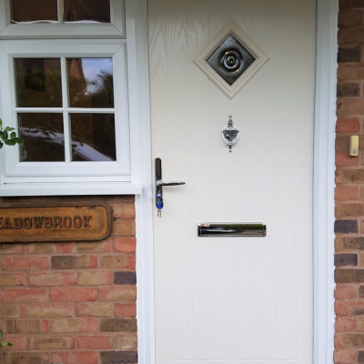 Image: 2019-12/belfry-front-door-in-cream-with-bullseye-glazing-and-chrome-hardware.jpg