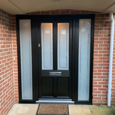 Image: 2020-01/ashwell-front-door-in-black-with-sandblast-opal-glazing-with-clear-borders-and-polished-chrome-hardware.jpg