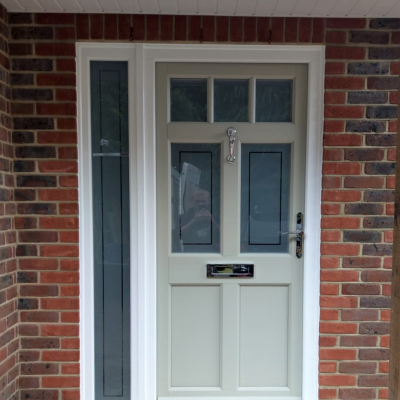 Image: 2020-01/ballingdon-front-door-in-olive-grey-and-side-panel-with-sandblast-glazing-incorporating-a-clear-border-and-regency-polished-chrome-hardware.jpg