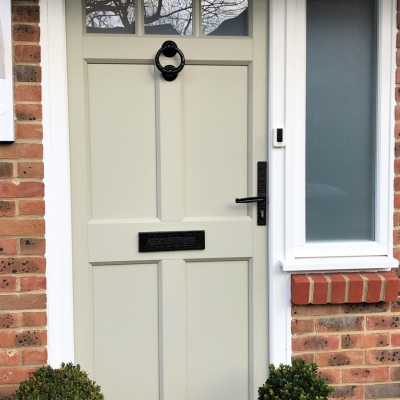 Image: 2020-01/ballingdon-front-door-in-olive-grey-woodgrain-finish-with-opal-sandblast-glazing-and-black-wrought-iron-hardware.jpg