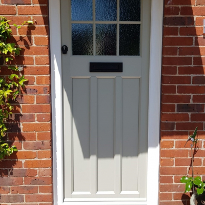 Image: 2020-01/boxmoor-front-door-in-olive-grey-with-minster-glazing-and-black-wrought-iron-hardware.jpg
