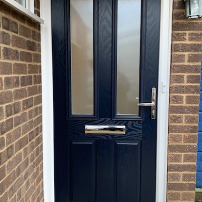Image: 2020-01/carnoustie-composite-door-in-standar-blue-with-toughened-obscure-glazing-and-gold-fittings.jpg