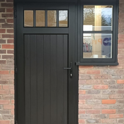 Image: 2020-01/shillington-front-door-in-black-woodgrain-with-clear-glazing-to-top-and-black-balmoral-hardware.jpg