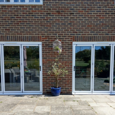 Image: 2020-01/two-3-pane-smarts-aluminium-bifolding-doors-in-matt-white-with-black-hardware-closed.jpg