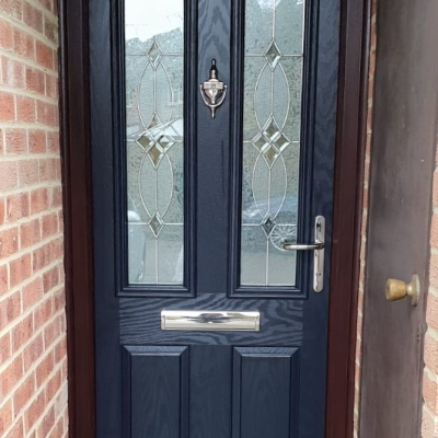 Image: 2020-02/carnoustie-composite-front-door-in-blue-with-rosewood-frame-flair-glazing-and-chrome-hardware.jpg