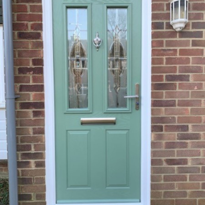 Image: 2020-02/carnoustie-composite-front-door-in-chartwell-green-with-reflections-glazing-and-stainless-steel-hardward.jpg