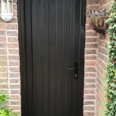 Image: 2020-02/shiplap-black-pvcu-back-door-in-black-brown-with-black-hardware.jpg