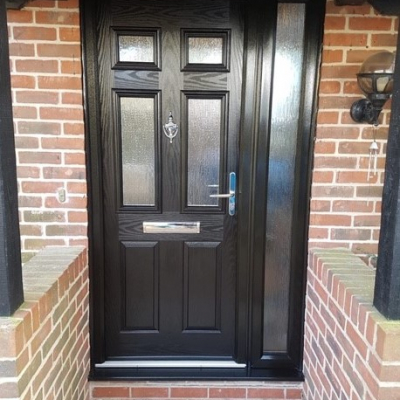 Image: 2020-03/troon-front-door-and-side-panel-in-black-with-cotswold-glazing-and-shiny-chrome-hardware.jpg